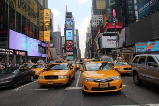 an exodus of yellow cabs at Times Square