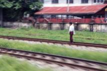 Man sauntering on the circular railway tracks.