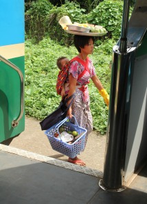 A villager spotted from the train. The train serves the suburban area of Yangon, mostly utilized by lower income families in inner Yangon.