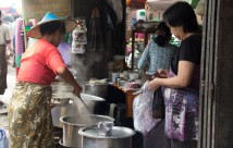 Woman selling soup at a morning wet market behind Aung Si Guest House (Ocean Pearl Inn 2 on Bo Gokye Road)